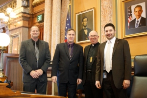Rep. Brian Moore (Bellevue), Rep. Josh Byrnes (Osage), and I with Archbishop Michael Jackels