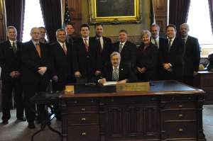 Brad Davis, other legislators and myself at the HF 2296 bill signing.